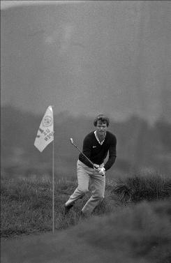 Tom Watson watches his ball go into the hole after hitting out of the rough during his memorable 17th hole during the 1982 U.S. Open at Pebble Beach.