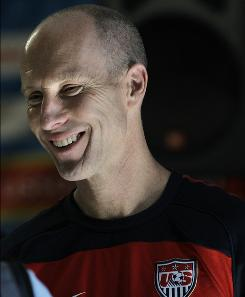 U.S. national soccer coach Bob Bradley shoots a rare smile after a news conference in Irene, South Africa on Sunday. Bradley is 37-19-7 since becoming the U.S. coach, a record he hopes to improve on Friday with a win against World Cup Group C opponent Slovenia.