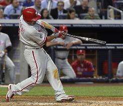 Philadelphia Phillies' Shane Victorino swings on a two-run homer during the fifth inning against the New York Yankees.