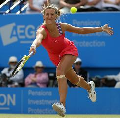 Victoria Azarenka of Belarus chases down a forehand during her quarterfinal victory against Kim Clijsters of Belgium on Thursday at the Aegon International.