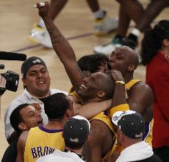 Lakers teammates Kobe Bryant, center, and Lamar Odom savor the moment after L.A.'s Game 7 victory in the NBA Finals.