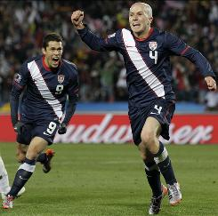 The USA's Michael Bradley, right, celebrates with teammate Herculez Gomez after scoring the tying goal against Slovenia late in the second half.