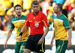 Australia's Harry Kewell, left, and Craig Moore plead their case to referee Roberto Rosetti after Kewell was red-carded in the 24th minute.