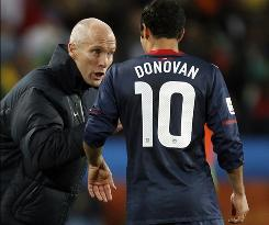 U.S. coach Bob Bradley gives instructions to Landon Donovan during their World Cup match against Slovenia.