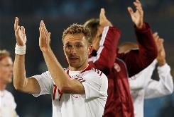 Denmark's Dennis Rommedahl applauds at the end of his team's Group E match with Cameroon.