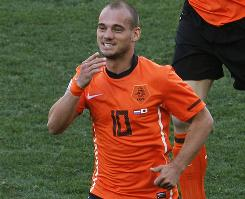 Wesley Sneijder celebrates after scoring the Netherlands' only goal against Japan, clinching their second straight World Cup win.
