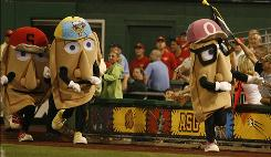 Costumed pierogis race between the fifth and sixth innings during the 2006 All-Star Game in Pittsburgh.