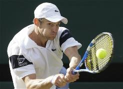 Andy Roddick plays a return to Roger Federer during their men's final match at Wimbledon in 2009.