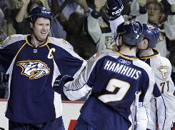 The Predators have traded center Jason Arnott, left, and defenseman Dan Hamhuis. They received a prospect for Arnott and Ryan Parent for Hamhuis.