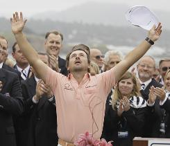Graeme McDowell of Northern Ireland celebrates at the trophy ceremony after winning the U.S. Open on Sunday at Pebble Beach.