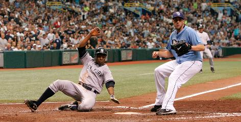 The Yankees' Curtis Granderson slides into home as Rays starting pitcher Andy Sonnanstine awaits the throw during an April 11 game. New York, Tampa Bay and the Boston Red Sox boast the three best records in baseball.