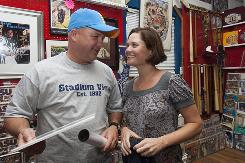 Baseball fans Brian and Toni Chandler of Jericho, Vt., smile in Omaha on Sunday after they were married at the Stadium View sports memorabilia store next to Rosenblatt Stadium. They were attending their first College World Series, and decided to get married during Sunday's 4-hour, 15-minute rain delay before the start of the South Carolina-Oklahoma game.
