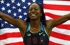 Sanya Richards-Ross celebrates winning the gold medal in the Women's 400m final at the World Athletics Championships in Berlin.