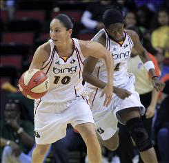"Seattle point guard Sue Bird, left, with forward Swin Cash trailing, says the Storm have good chemistry. ""We've been together a couple of years now...and it's easy to play with one another."""