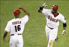 Justin Upton, getting a high-five from third base coach Bo Porter, homered twice and drove in four runs to help the Diamondbacks beat the Yankees 10-4.