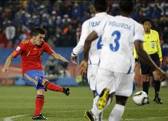 Spain's David Villa scores his second goal against Honduras during the 51st minute. Villa missed a chance for a hat trick when he shot wide from the penalty spot in the 62nd minute.