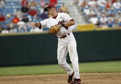 South Carolina infielder Scott Wingo throws to first for an out against Arizona State in the sixth inning during Game 7 of the 2010 College World Series championships at Rosenblatt Stadium. The Gamecocks advance to another elimination game Thursday.