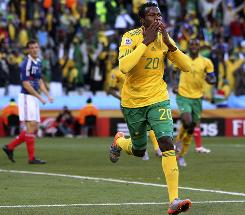 Bongani Khumalo celebrates his 20th-minute goal against France. Despite a good effort by the South African side, they became the first host nation to not advance to the Round of 16.