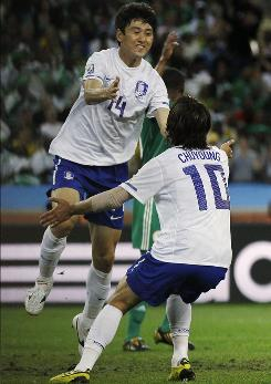 South Korea's Lee Jung-soo, left, celebrates with Park Chu-young after scoring his side's first goal against Nigeria.