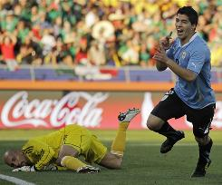 Uruguay's Luis Suarez celebrates scoring past Mexico goalkeeper Oscar Perez during the first half. Suarez's strike won Group A for the South Americans.