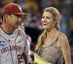 ESPN personality Erin Andrews, right, speaks to Oklahoma coach Sunny Golloway between innings of a NCAA College World Series game. Andrews' contract expires July 1, meaning the CWS could be her last assignment for ESPN.
