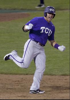 TCU's Matt Curry reacts as he rounds the bases after hitting a grand slam against Florida State in the eighth inning of the College World Series elimination game in Omaha.