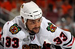 Dustin Byfuglien, who played a crucial role for the Blackhawks in their run to the Stanley Cup title, was shipped to the Thrashers to clear salary cap space.