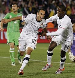 Team USA's Landon Donovan celebrates his late goal against Algeria with teammate Edson Buddle. The Americans finish first in Group C after their 1-0 win and will play Ghana in the Round of 16 on Saturday.