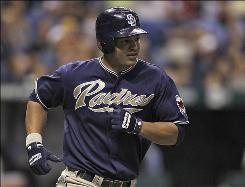 The Padres' Will Venable rounds the bases after hitting a two-run homer in the fifth-inning, breaking a scoreless tie.