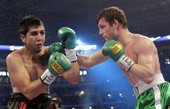 John Duddy, right, beat Michael Medina to set up Saturday's bout against Julio Cesar Chavez Jr.