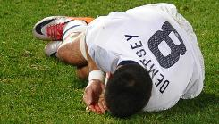 The USA's Clint Dempsey catches blood from his lip during Wednesday's win against Algeria. Dempsey had an apparent goal denied in a previous game against Slovenia.