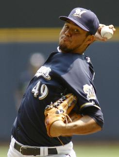 Brewers' Yovani Gallardo improved to 7-3 after a complete game shutout of the Twins.