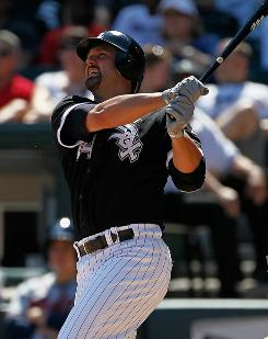 White Sox's Paul Konerko hits the game-winning home run, a two-run shot in the 8th inning, to beat the Braves 2-0.