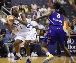 Mystics forward Crystal Langhorne, left, with the Sparks' Delisha Milton-Jones defending, scored 17 of her career-high 27 points before halftime.