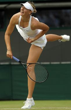 Maria Sharapova of Russia follows through on one of her big shots during her second-round victory against a ball to Romania's Ioana Raluca Olaru on Wednesday at Wimbledon.
