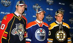 The top three picks of the 2010 draft are Taylor Hall, Edmonton Oilers, center; Tyler Seguin, Boston Bruins, right, and Erik Gudbranson, Florida Panthers.
