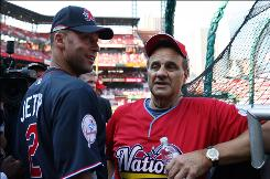 "The Yankees' Derek Jeter, left, visits with Joe Torre at the 2009 All-Star Game. Jeter still refers to the Dodgers manager as ""Mr. T."""