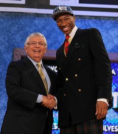 Wesley Johnson poses with NBA commissioner David Stern after the Minnesota Timberwolves made him the No. 4 pick in the draft.