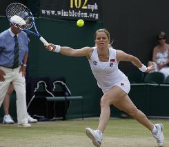 Kim Clijsters of Belgium chases down a forehand during her straight-sets, third-round victory against Maria Kirilenko of Russia on Friday at Wimbledon.