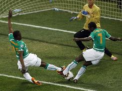 Ivory Coast's Seydou Doumbia, left, scores a goal that was later disallowed against North Korea.