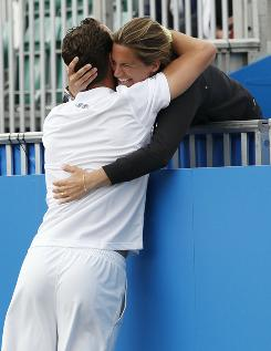 Michael Llodra of France embraces his coach, former French star Amelie Mauresmo, after winning a match on the way to a title at Eastbourne.