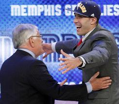 NBA commissioner David Stern, left, embraces Maryland's Greivis Vasquez, who was selected 28th overall by the Memphis Grizzlies in the first round of the NBA draft Thursday night in New York.