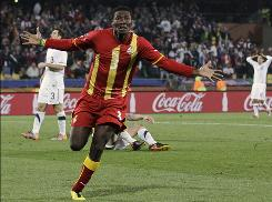 Ghana's Asamoah Gyan celebrates the game-winning goal against the USA in extra time.