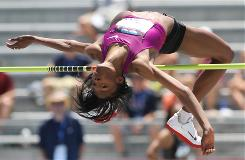 Chaunte Lowe clears the bar on her way to setting a new American high jump record of 6 feet, 8 3/4 inches.