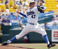 UCLA pitcher Trevor Bauer struck out 13 in eight innings to lead the Bruins into the best-of-three final of the College World Series.