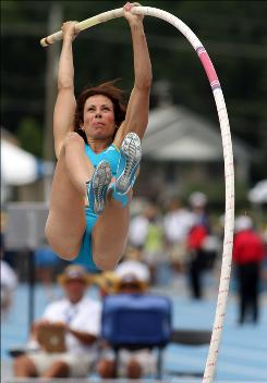 Women's pole vault winner Jenn Suhr lifts herself at the USA Outdoor Track and Field Championships in Des Moines on Sunday.