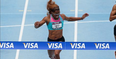 Consuella Moore crosses the finish line and wins the womens 200-meter event during the 2010 USA Outdoor Track and Field Championships in Des Moines on Sunday.