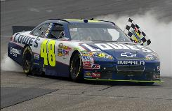 Jimmie Johnson performs a burnout to celebrate winning the LENOX Industrial Tools 301 at New Hampshire Motor Speedway on Sunday in Loudon, New Hampshire.