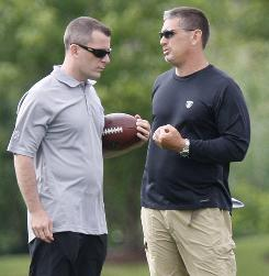 Detroit Lions president Tom Lewand, left, talks with head coach Jim Schwartz during a minicamp workout on Thursday.