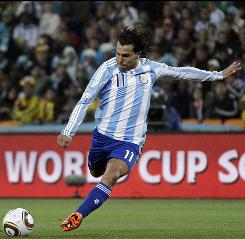 Argentina's Carlos Tevez, right, scores his side's third goal during the World Cup round of 16 match between Argentina and Mexico in Johannesburg, South Africa.